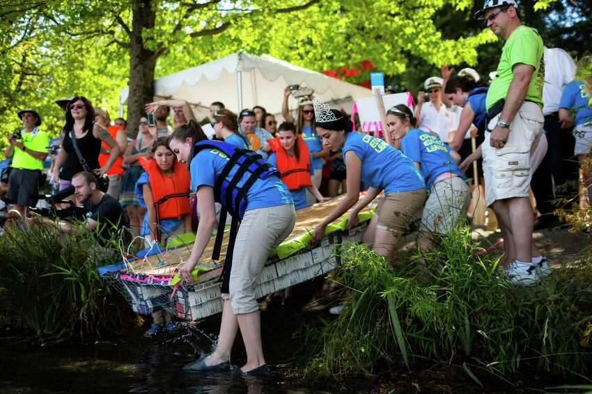 Competitors load their do-it-yourself-styled boats into the water in preparation for the 43rd annual Seafair Milk Carton Derby Saturday, July 12, 2014, in Seattle, Wash. Nearly 100 colorful milk carton boats took part in the festivities.