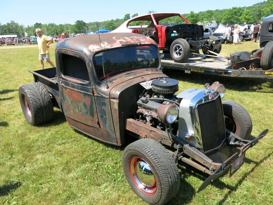 "1937 Chevrolet, with a 1988 350 CID Chevrolet engine, Mercedes-Benz grille, Harley-Davidson mufflers and front turn signals. ""I drive it everywhere,"" said owner Jim Greenlaw of Trenton ME. ""If you see it on a trailer, you know it's stolen."""