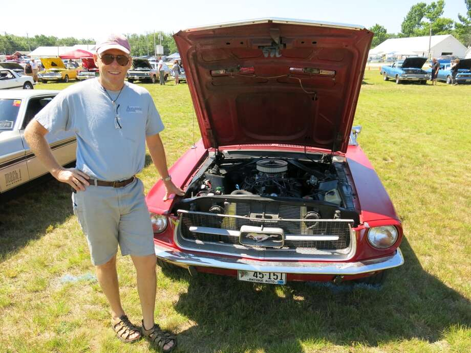 1967 Ford Mustang convertible with its owner, Sean Guinness, Blue Hill ME.