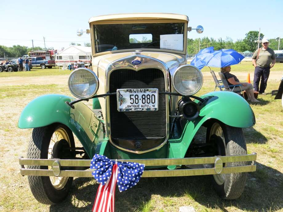 A 1930 Ford Model A displayed at the Blue Hill (Maine) Car Show on July 12, 2014. (All photos by Michael Taylor. Names of owners and where the cars came from are taken from information displayed on the individual windshields.)