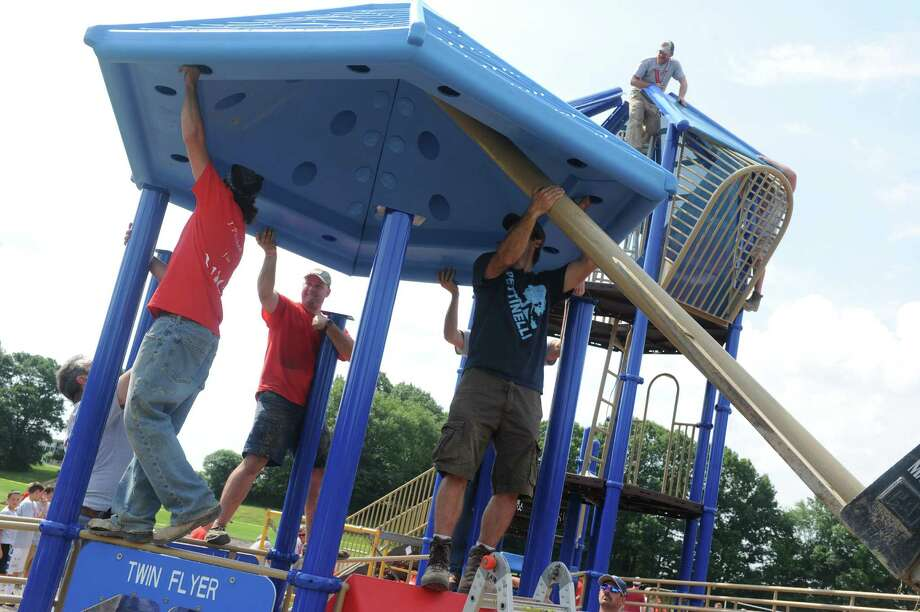 Pitch in for Vin, volunteers assemble and build a new playground, all in celebration of the Vincenzo Rizzo Memorial Fund at Blue Creek Elementary School on Saturday July 12, 2014 in Latham, N.Y. (Michael P. Farrell/Times Union) Photo: Michael P. Farrell / 00027764A