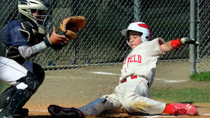 Fairfield American's Vince Camera slides into home plate as Westport's Luc Yokoi looks to make the tag, during little league action at Unity Park in Trumbull, Conn. on Saturday July 12, 2014. Camera was called safe.