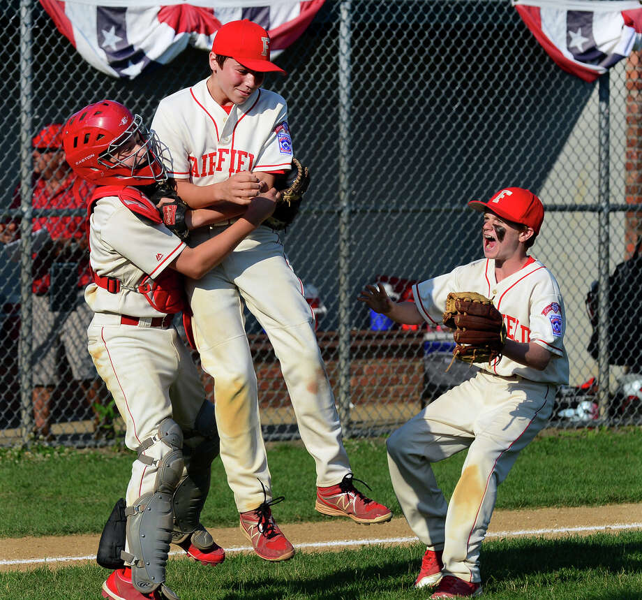 Fairfield American celebrates its victory over Westport, during little league action at Unity Park in Trumbull, Conn. on Saturday July 12, 2014. In center being surrounded is pitcher PJ Egan. Photo: Christian Abraham / Connecticut Post