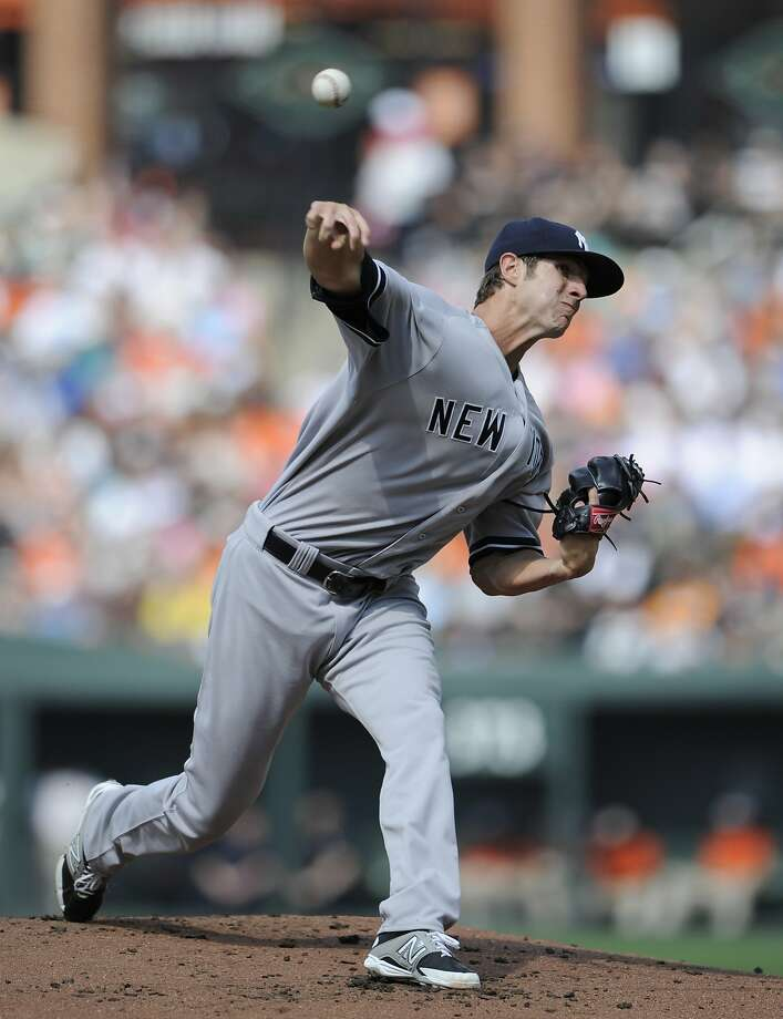 New York rookie Shane Greene improved to 2-0 by holding Baltimore to four hits in 71/3 innings of the Yankees' 3-0 victory Saturday. Photo: Nick Wass, Associated Press