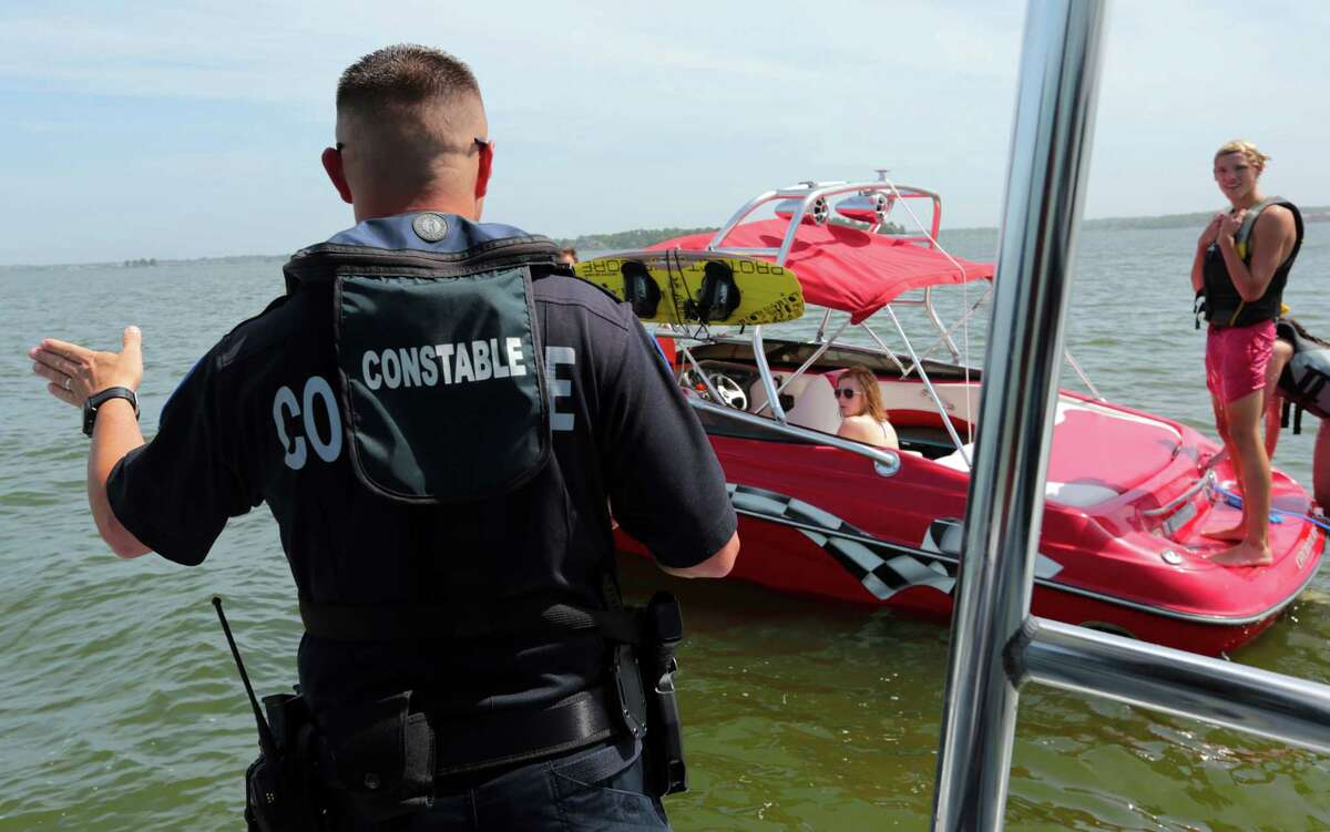 Lt. Tim Cade stops a boater on Lake Conroe for a safety check on Wednesday. All boaters are required to have life vests for each passenger onboard.