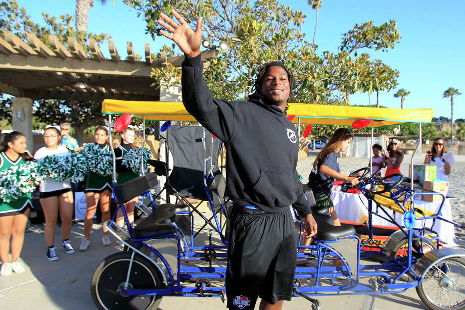 "Above: Lonnie Ballentine embraced his ""Mr. Irrelevant"" designation last week in Newport Beach, Calif., where he greeted the crowd at the Mr. Irrelevant Week Arrival Party. Photo: Kevin Chang/ Daily Pilot / Daily Pilot"