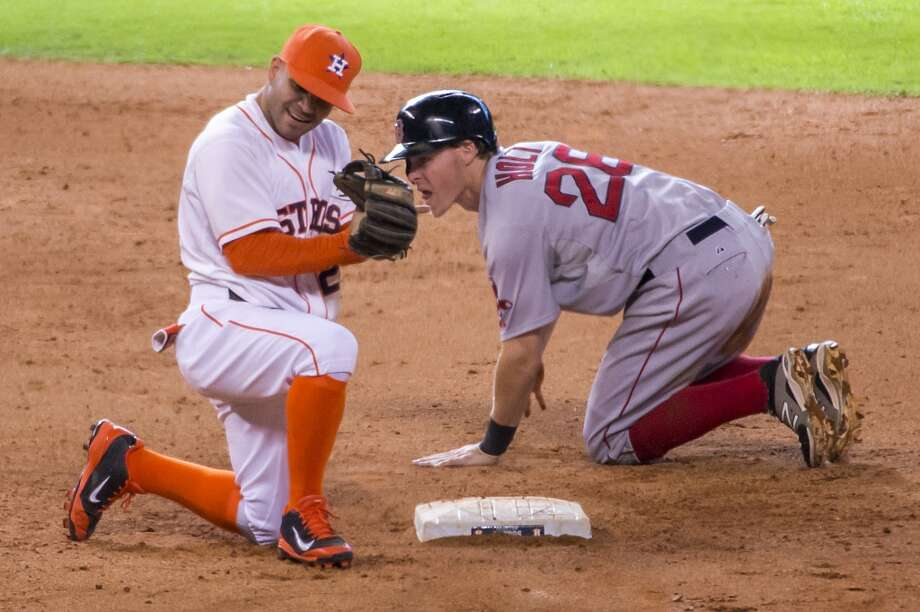 July 12: Astros 3, Red Sox 2Astros second baseman Jose Altuve a game-ending double play to preserve a 3-2 Astros victory. Photo: Smiley N. Pool, Houston Chronicle