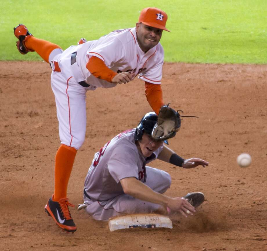 Astros Jose Altuve makes the relay over Brock Holt to complete a game-ending double play. Photo: Smiley N. Pool, Houston Chronicle