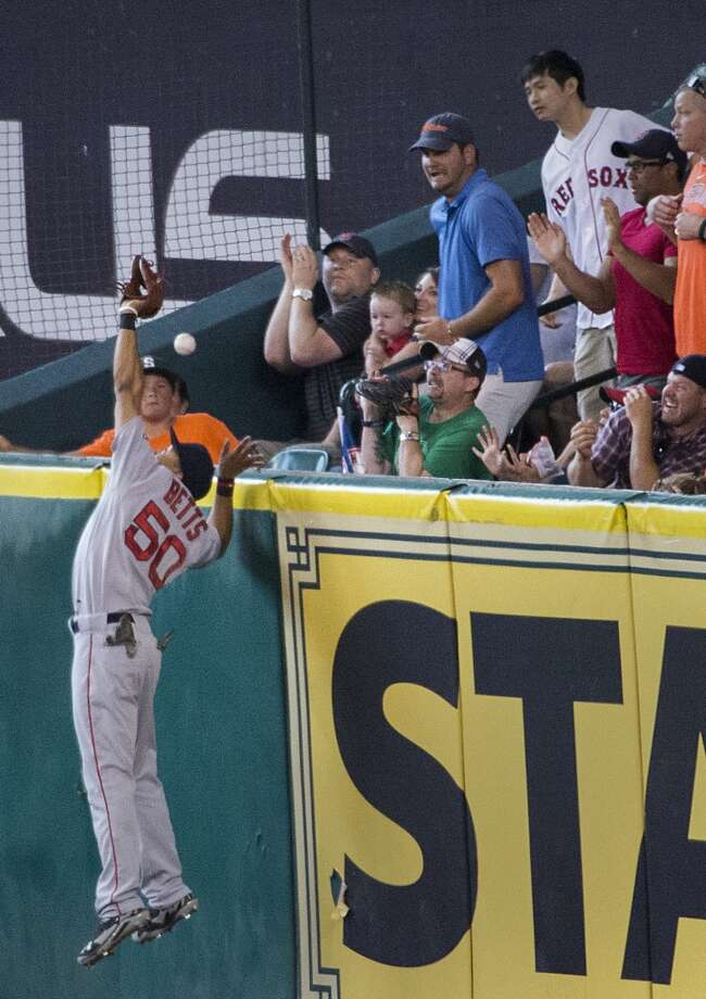 Boston right fielder Mookie Betts can't make the play at the wall on a two-run home run by Astros catcher Jason Castro. Photo: Smiley N. Pool, Houston Chronicle