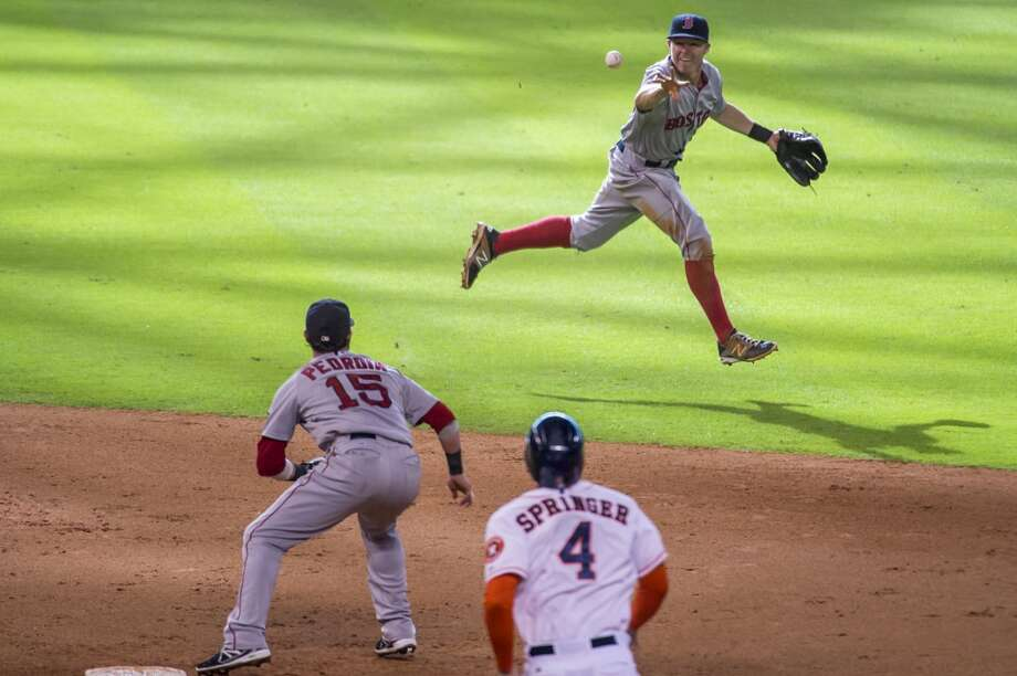 Red Sox shortstop Brock Holt makes a toss that pulled Dustin Pedroia off the bag, leaving  George Springer and allowing Jose Altuve to score from third for the go-ahead run during the eighth inning. Photo: Smiley N. Pool, Houston Chronicle