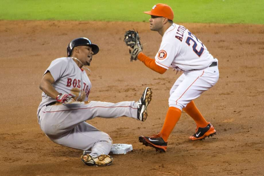 Boston's Xander Bogaerts tumbles away from the bag after being tagged by Astros second baseman Jose Altuve attempting to stretch a hit into a double during the second inning. Photo: Smiley N. Pool, Houston Chronicle