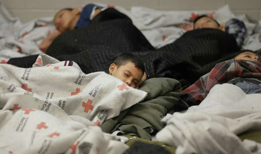 FILE - This June 18, 2014, file photo, detainees sleep in a holding cell at a U.S. Customs and Borde