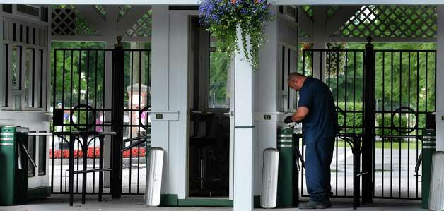 NYRA maintenance worker Paul Botta checks turn styles at the Saratoga Race Course Wednesday morning July 9, 2014 in preparation for Sunday's Family Day at the historic thoroughbred track in Saratoga Springs, N.Y.           (Skip Dickstein / Times Union) Photo: SKIP DICKSTEIN