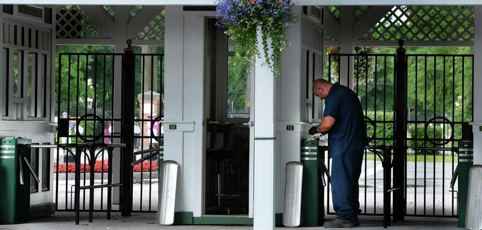 NYRA maintenance worker Paul Botta checks turn styles at the Saratoga Race Course Wednesday morning