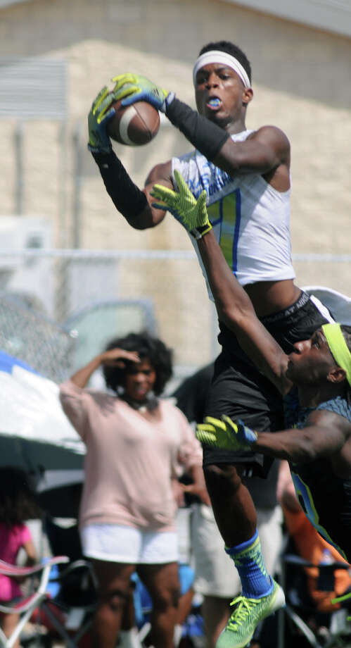 Seven Lakes senior wide receiver Braeden West goes up and over a Whitehouse defender to a make a catch during the championship game at the state 7-on-7 football tournament at Veterans Park and Athletic Complex in College Station on Saturday. Photo: Jerry Baker, For The Chronicle