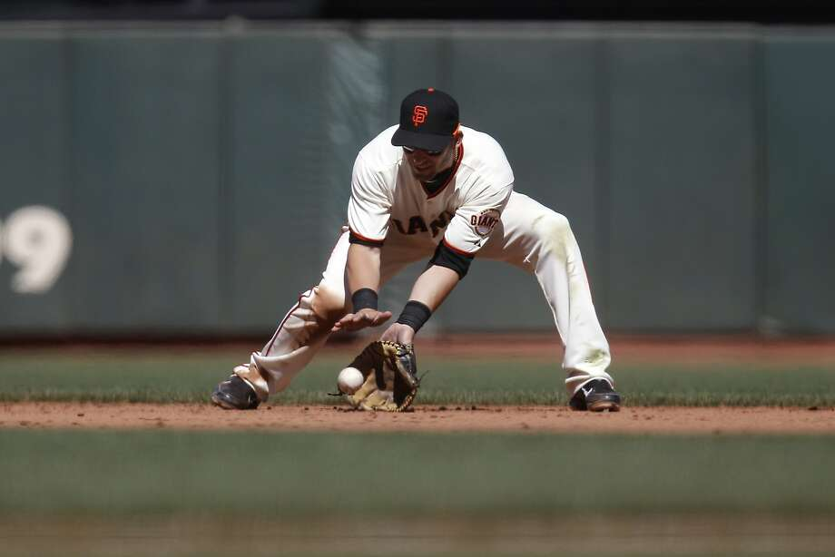 Marco Scutaro played all nine innings at second base in his first game back and went 0-for-3 with a walk. Photo: Michael Short, The Chronicle