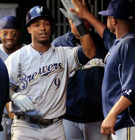 Milwaukee Brewers Jean Segura (9) is congratulated by teammates after hitting a home run in the fourth inning of a baseball game against the Cincinnati Reds in Cincinnati, Friday May 10, 2013. (AP PhotoTom Uhlman) Photo: Tom Uhlman, FRE / FR31154 AP