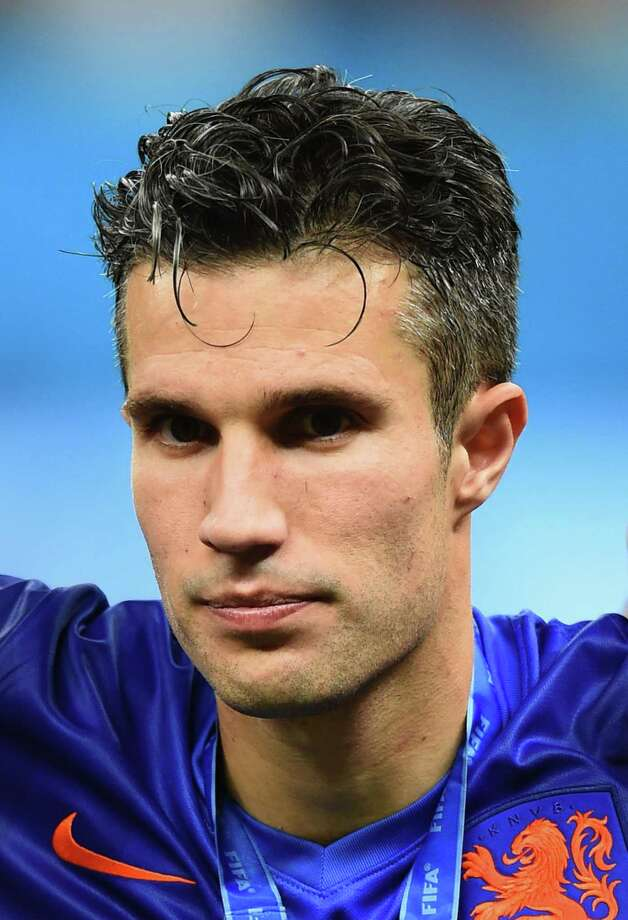 BRASILIA, DF - JULY 12:  Robin van Persie of the Netherlands looks on with his medal after defeating Brazil 3-0 during the 2014 FIFA World Cup Brazil Third Place Playoff match between Brazil and the Netherlands at Estadio Nacional on July 12, 2014 in Brasilia, Brazil.  (Photo by Buda Mendes/Getty Images) ORG XMIT: 491932375 Photo: Buda Mendes / 2014 Getty Images