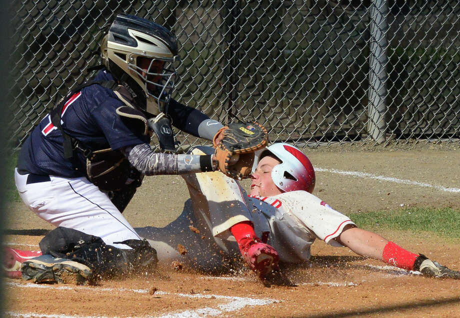 Fairfield American's Vince Camera slides into home plate as Westport's Luc Yokoi looks to make the tag, during little league action at Unity Park in Trumbull, Conn. on Saturday July 12, 2014. Camera was called safe. Photo: Christian Abraham / Connecticut Post