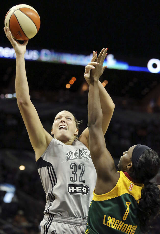 Center Jayne Appel (left) is more assertive and leads the Stars in field-goal percentage, rebounds and blocks. Photo: Edward A. Ornelas, San Antonio Express-News / © 2014 San Antonio Express-News