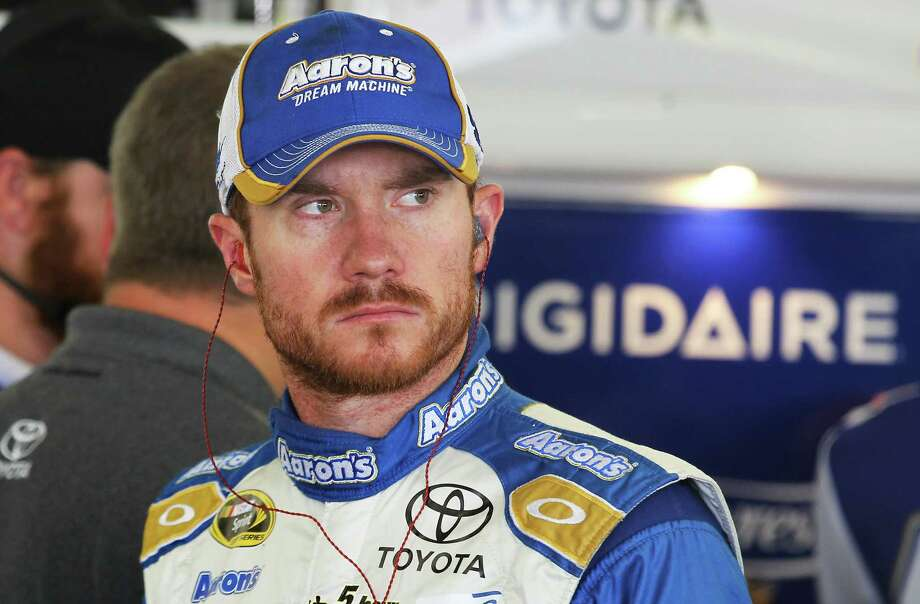 Driver Brian Vickers waits for his car, Friday, July 11, 2014 in Loudon, N.H., on during practice for Sunday's NASCAR Sprint Cup Series Auto Race race at New Hampshire Motor Speedway. (AP Photo/Cheryl Senter) ORG XMIT: NHCS102 Photo: Cheryl Senter / FR62846 AP