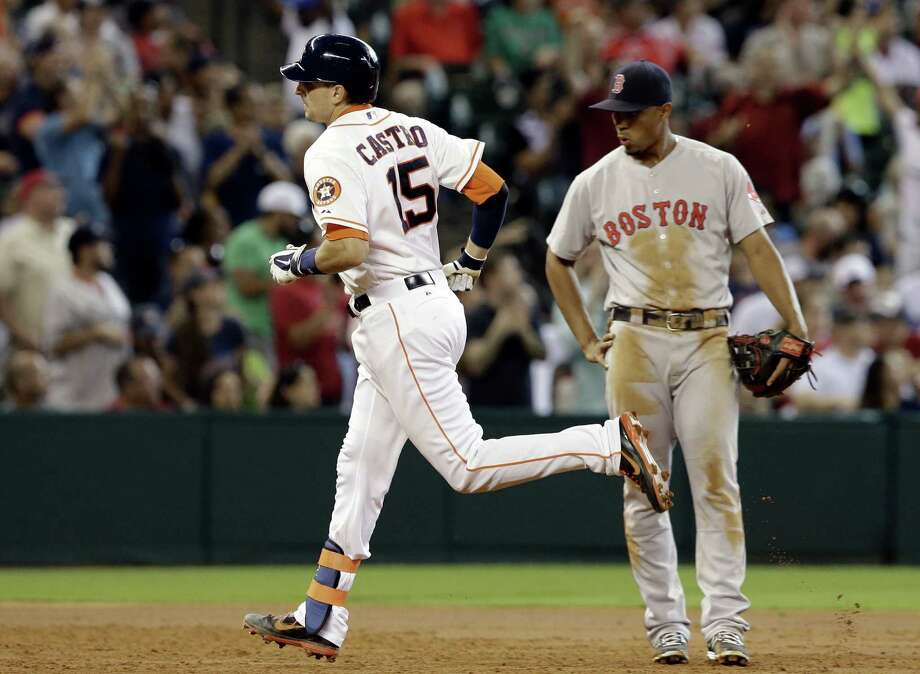 The Astros' Jason Castro rounds the bases in front of Red Sox third baseman Xander Bogaerts after his two-run home run in the third inning Saturday at Minute Maid Park. Photo: Pat Sullivan / Associated Press / AP