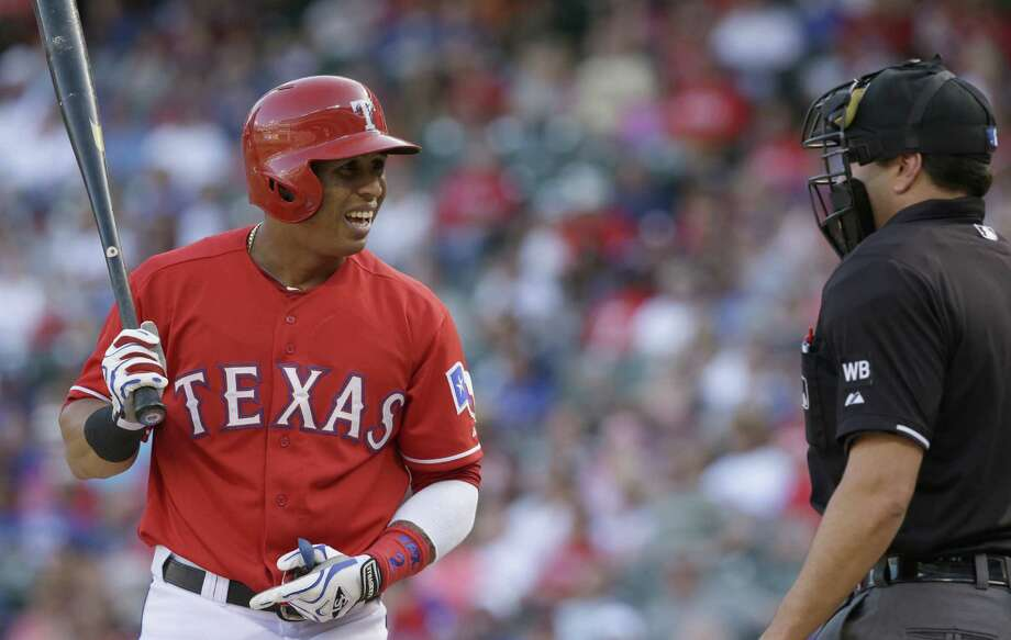 The Rangers' Leonys Martin (left) reacts to a strike three call by home plate umpire Jim Reynolds to end the first inning Saturday at Globe Life Park in Arlington. Martin was 0 for 4. Photo: LM Otero / Associated Press / AP