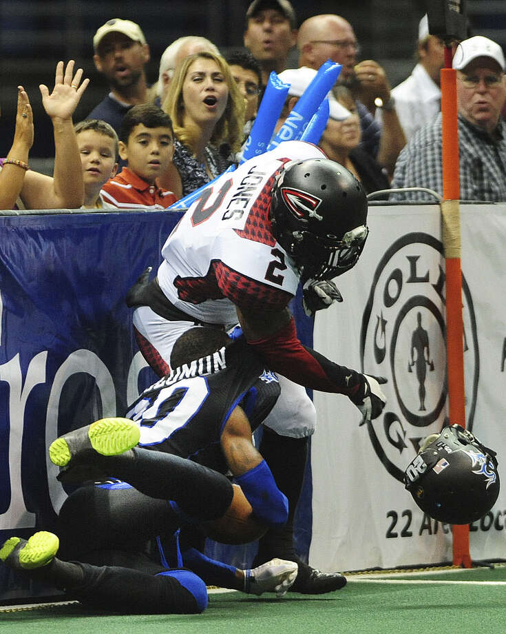 Talons receiver Clinton Solomon (left), who had a team-high 53 receiving yards, loses his helmet after being hit by Cleveland's Dominic Jones during Saturday's game at the Alamodome. Photo: Billy Calzada / San Antonio Express-News / San Antonio Express-News