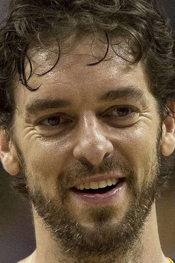 Pau Gasol may get more from Chicago than what the Spurs are able to offer with their mid-level exception. / The Canadian Press
