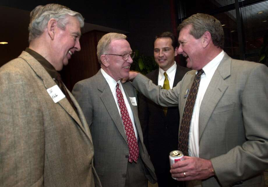 Mayoral candidate Ed Garza, center right, is surrounded by supporters, l to r, Cliff Morton, Bob Coleman, and Bill Greehey at a fundraiser, Feb. 28, 2001, at Valero. Photo: BOB OWEN, SAN ANTONIO EXPRESS-NEWS