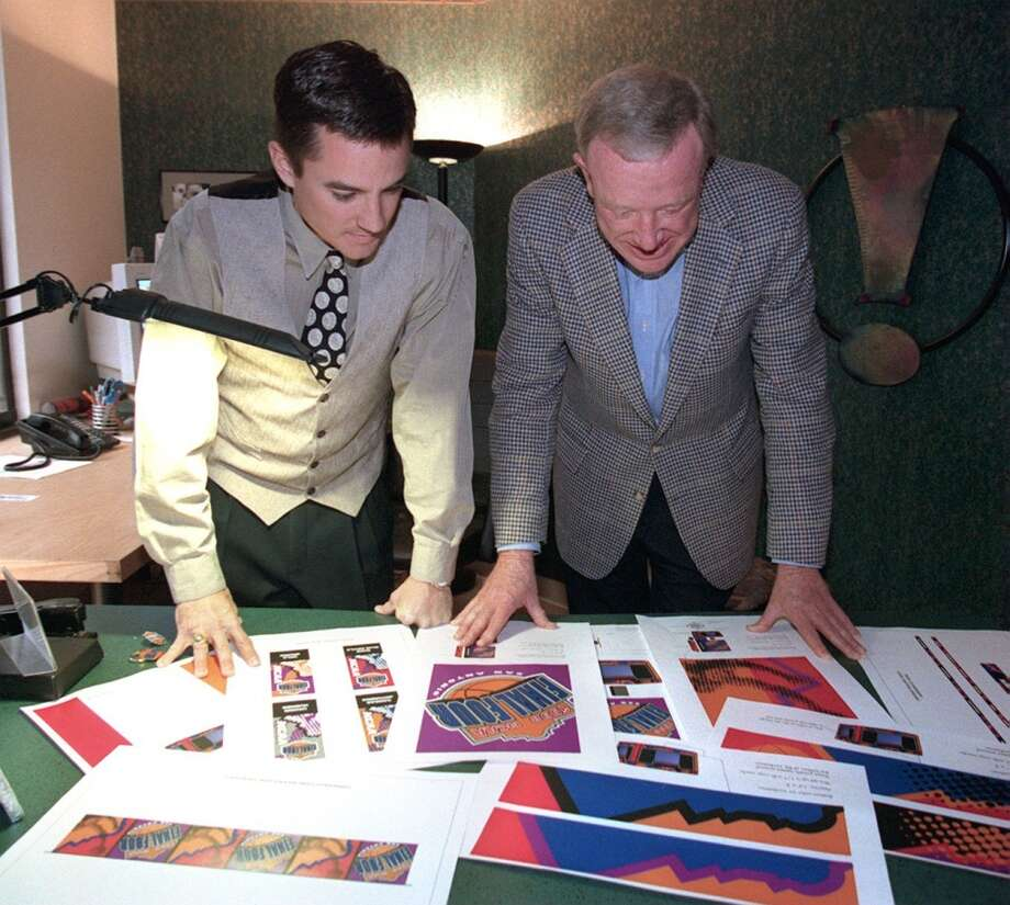 Erik Darmstetter, of Creative Link Studio and Bob Coleman look at Final Four logos for the event, Thursday at the Creative Link Studio. 2/12/98. Photo: MORRIS GOEN, SAN ANTONIO EXPRESS-NEWS