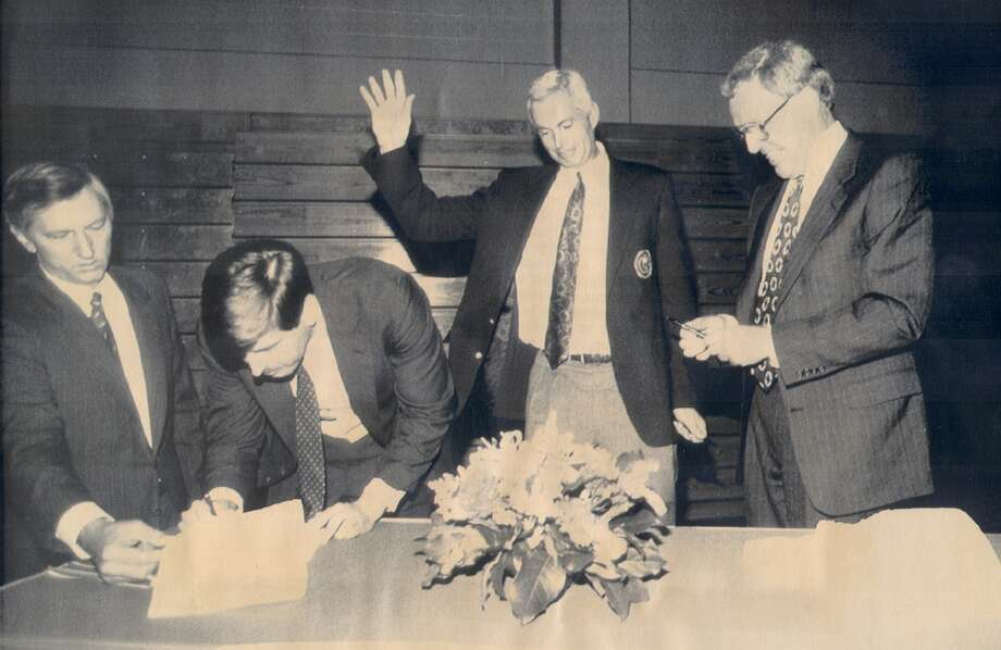 Olympic Festival officials Gary Alexander, left, Robert Marbut Jr., Dr. Harvey Schiller and Bob Coleman are on hand to sign the contract, making San Antonio the site of the 1993 Festival. Photo: Express-News File Photo