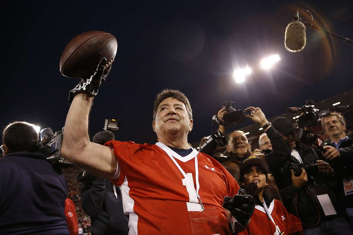 Former San Francisco 49ers owner Eddie DeBartolo Jr. holds the ball after the Legends of Candlestick flag football game at Candlestick Park in San Francisco, Calif. on Saturday, July 12, 2014.