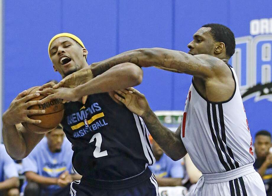 Jarnell Stokes (2) grabs a rebound away from Tarik Black. Photo: John Raoux, Associated Press