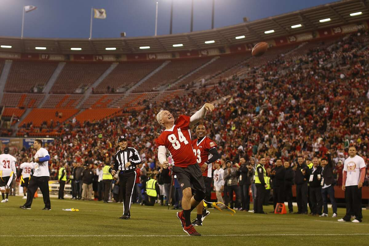 Former San Francisco 49ers wide receiver Mike Shumann (84) tosses the ball into the stands after scoring a touchdown during the second half of the Legends of Candlestick flag football game at Candlestick Park in San Francisco, Calif. on Saturday, July 12, 2014.