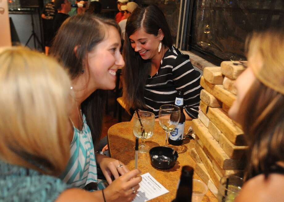 From left, Marquis Beard, Stephanie Provost, Kourtney Benoit and Amber Lomasney play trivia at Dylan's in Port Arthur on Tuesday. Photo taken Tuesday, September 10, 2013 Guiseppe Barranco/The Enterprise Photo: Guiseppe Barranco/The Enterprise
