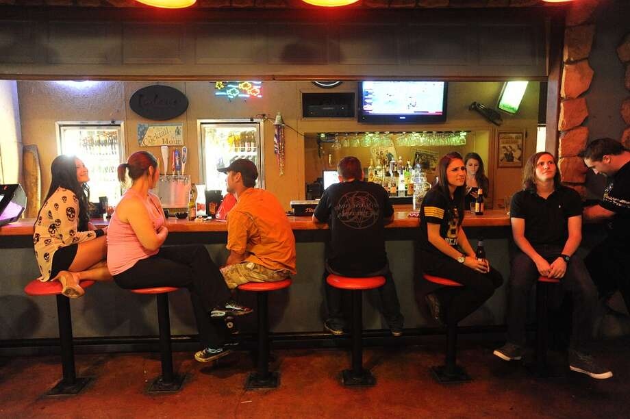 Dylan's guests huddle at the back bar during a game of trivia in Port Arthur on Tuesday. Photo taken Tuesday, September 10, 2013 Guiseppe Barranco/The Enterprise Photo: Guiseppe Barranco/The Enterprise