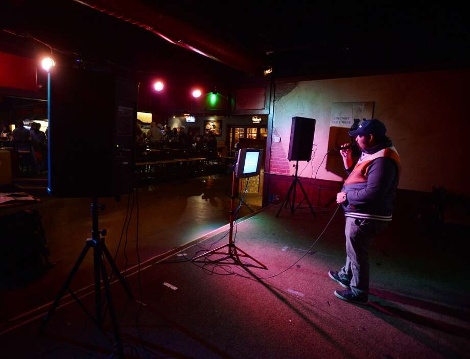 "Derek Orta sings ""Wonderwall"" by Oasis during his turn in the karaoke spotlight at Dylan's on Wednesday. Dylan's Bar and Grill in Port Arthur hosts karaoke on Wednesday nights. Photo taken Wednesday, 2/12/14 Jake Daniels/@JakeD_in_SETX"
