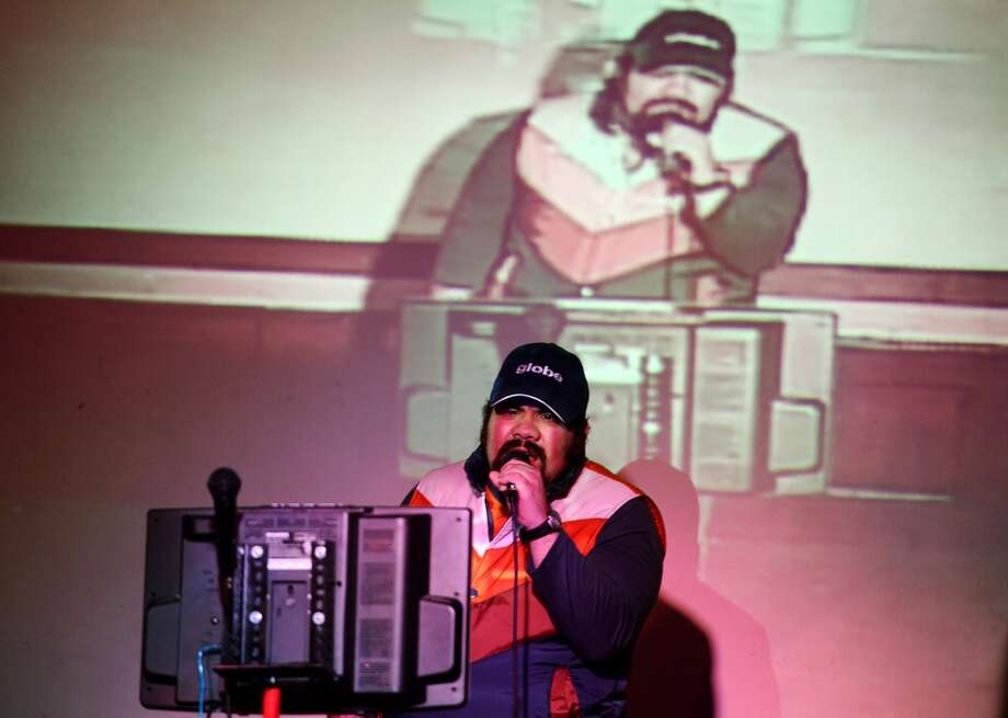 "Derek Orta sings ""Wonderwall"" by Oasis during his turn in the karaoke spotlight at Dylan's on Wednesday. Dylan's Bar and Grill in Port Arthur hosts karaoke on Wednesday nights. Photo taken Wednesday, 2/12/14 Jake Daniels/@JakeD_in_SETX"