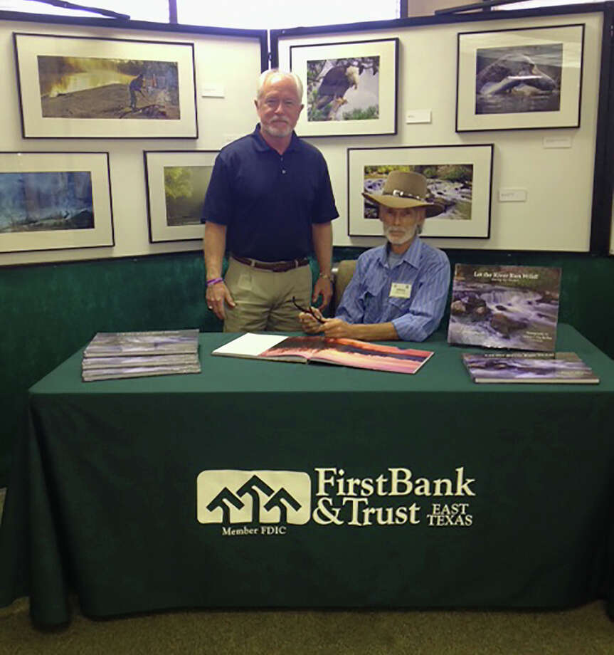 Eddie Hopkins with photographer Adrian F. Van Dellen at First Bank & Trust complimentary photo