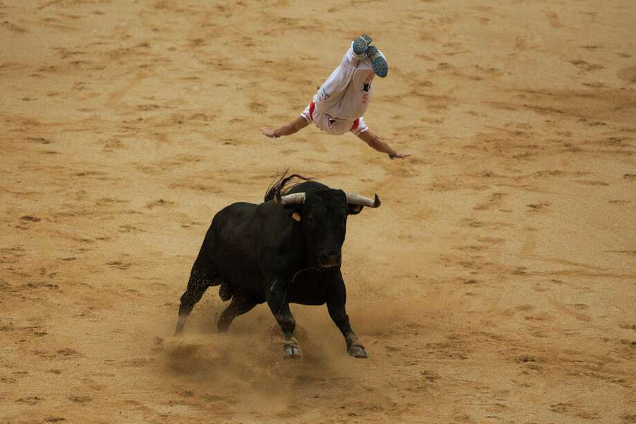 A ''recortador'' jumps over a bull during a competition at the San Fermin festival, in Pamplona, Spain, Saturday, July 12, 2014. Revelers from around the world arrive in Pamplona every year to take part in some of the eight days of the running of the bulls. Photo: Andres Kudacki, AP  / AP