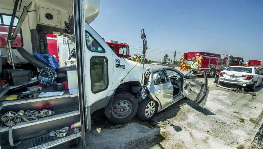 Emergency personnel work at the scene of a chain-reaction crash involving a big rig, a small bus, and three passenger vehicles, Thursday, July 10, 2014, on the westbound 210 Freeway in Pasadena, Calif. KNBC-TV says six injuries are reported, including several people in wheelchairs. (AP Photo/The Pasadena Star-News, Walt Mancini)  MAGS OUT; NO SALES; MANDATORY CREDIT Photo: Walt Mancini, AP  / The Pasadena Star-News