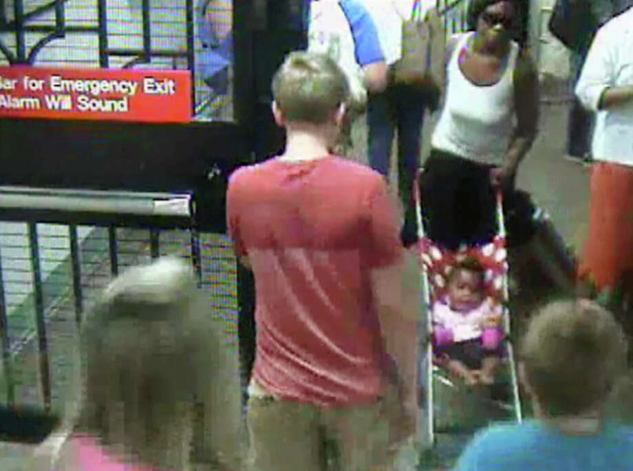In this Monday, July 7, 2014 surveillance camera image provided by the New York Police Department, a woman, top right, pushes her baby girl in a stroller at the Columbus Circle subway station in New York. The 20-year-old woman, who is suspected of abandoning the baby at the Manhattan station, was in police custody on Tuesday. Photo: Uncredited, AP  / AP
