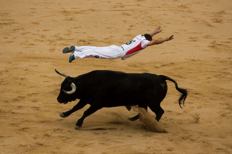 A ''recortador'' jumps over a bull during a competition at the San Fermin festival, in Pamplona, Spain, Saturday, July 12, 2014. Revelers from around the world arrive in Pamplona every year to take part in some of the eight days of the running of the bulls. Photo: Andres Kudacki, AP  / AP2014