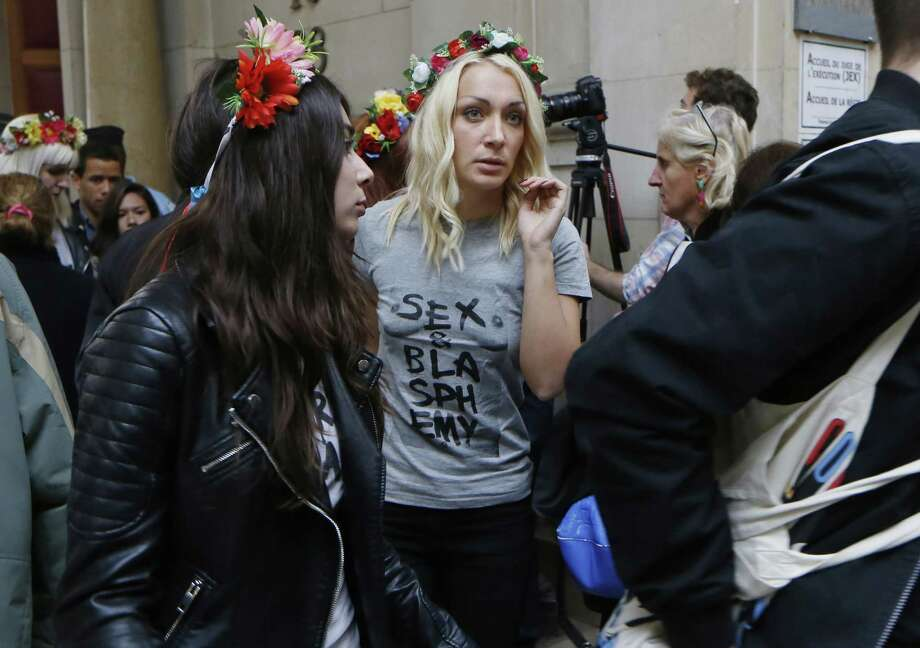 "Leader of the women's rights organisation Femen, Inna Shevchenko (C), leaves a Paris courthouse after attending the trial of nine other Femen members, on July 9, 2014 in Paris. The nine women are accused of ""damage to a place of worship in a group"" after participating in a demonstration at Notre-Dame de Paris in February 2013. AFP PHOTO / THOMAS SAMSON        (Photo credit should read THOMAS SAMSON/AFP/Getty Images) Photo: THOMAS SAMSON, Getty Images  / AFP"