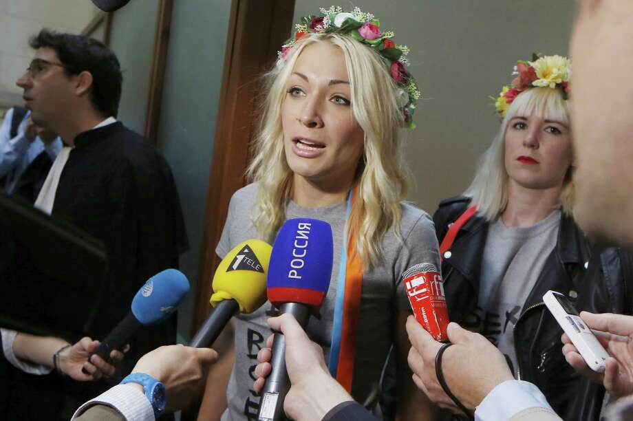 "Leader of the women's rights organisation Femen, Inna Shevchenko, speaks to journalists before attending the trial of nine other Femen members, on July 9, 2014 at the Paris Courthouse. The nine women are accused of ""damage to a place of worship in a group"" after participating in a demonstration at Notre-Dame de Paris in February 2013. AFP PHOTO / THOMAS SAMSON Photo: THOMAS SAMSON, Getty Images  / AFP"