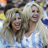 Argentine supporters pose before the World Cup final soccer match between Germany and Argentina at the Maracana Stadium in Rio de Janeiro, Brazil, Sunday, July 13, 2014. (AP Photo/Natacha Pisarenko)