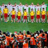 Germany  players line up on the pitch for the National Anthem prior to the 2014 FIFA World Cup Brazil Final match between Germany and Argentina at Maracana on July 13, 2014 in Rio de Janeiro, Brazil.
