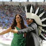 Brazilian singers Ivete Sangalo, left, and Carlinhos Brown perform during the closing ceremony for the World Cup before the final match between Germany and Argentina at Maracana Stadium in Rio de Janeiro, Brazil, Sunday, July 13, 2014. (AP Photo/Frank Augstein)