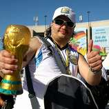 An Argentina fan holds a replica of the World Cup trophy outside the stadium prior to the 2014 FIFA World Cup Brazil Final match between Germany and Argentina at Maracana on July 13, 2014 in Rio de Janeiro, Brazil.